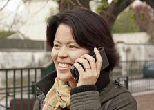 Smiling woman on the phone Stock Photography