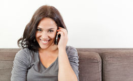 Smiling woman on the phone Stock Image