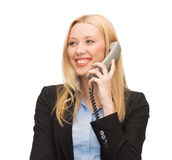 Smiling woman with phone Royalty Free Stock Image