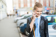 Smiling woman on the phone in city center Stock Photos