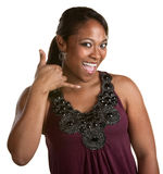 Smiling Woman with Phone Gesture Stock Image