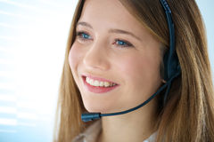Smiling woman phone operator Stock Images