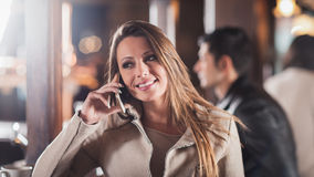 Smiling woman on the phone Royalty Free Stock Photo