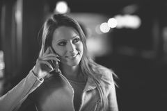 Smiling woman on the phone Royalty Free Stock Image