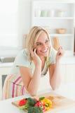 Smiling woman phoning Royalty Free Stock Image