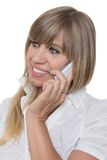 Smiling Woman is phoning with a smart phone Royalty Free Stock Image