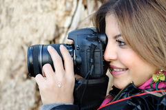 Smiling woman and photo camera Royalty Free Stock Image