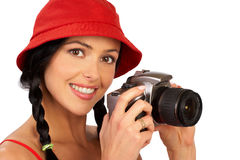 Smiling woman and photo camera. Stunning young smiling woman holding a photo camera