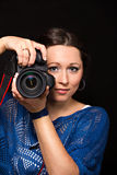 Smiling woman and photo camera Royalty Free Stock Photos