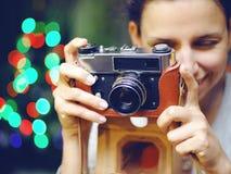 Smiling woman photographed retro camera. Stock Photos