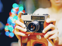 Smiling woman photographed retro camera. Stock Photography