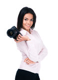 Smiling woman photographer holding camera. Isolated on a white background. Looking at camera Royalty Free Stock Image