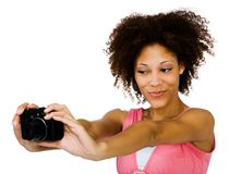 Smiling woman photographing herself Stock Image