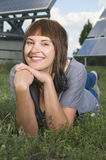 Smiling woman between photovoltaics Stock Image