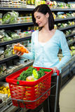 Smiling woman picking vegetables Stock Photo