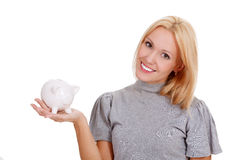 Smiling woman with piggy bank Royalty Free Stock Images