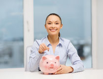 Smiling woman with piggy bank and cash money Stock Photography