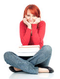 Smiling woman and pile of books Stock Photos