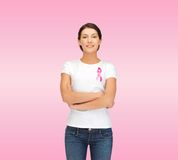 Smiling woman with pink cancer awareness ribbon Stock Image