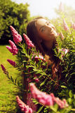 Smiling woman with pink flowers Royalty Free Stock Photo