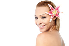 Smiling woman with pink lily flower Stock Image