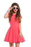 Smiling Woman In Pink Mini Dress And Sunglasses Stock Images