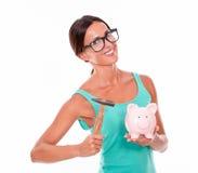 Smiling woman with pink piggy bank Stock Photos