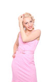 Smiling woman in a pink spotted dress Stock Images