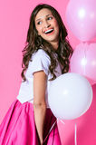 Smiling woman with pink and white balloons Stock Photography