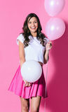 Smiling woman with pink and white balloons Royalty Free Stock Photo