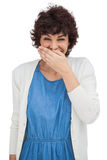 Smiling woman placing her hand on her mouth Stock Photos