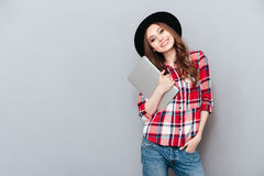 Smiling woman in plaid shirt holding laptop Royalty Free Stock Photos