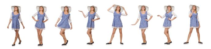 Smiling woman in plaid simple dress and hat isolated on the whit. E Royalty Free Stock Image
