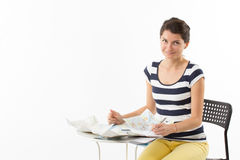 Smiling woman planning a trip Royalty Free Stock Photo