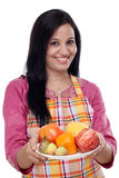 Smiling woman with plate of fruits Royalty Free Stock Photo