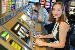 Smiling woman playing arcade game stock photo