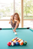 Smiling woman playing pool. Royalty Free Stock Images