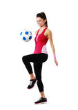 Smiling woman playing with soccer ball Royalty Free Stock Images