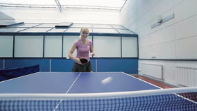 Smiling woman playing the table tennis at the court stock video
