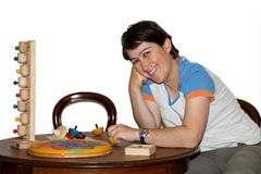 Smiling woman plays with toys isolated Royalty Free Stock Images