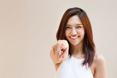 Smiling woman point finger at you, positive mood Stock Photos