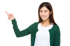 Smiling woman pointing away, copy space concept Stock Photos