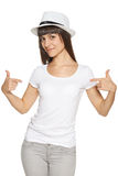 Smiling woman pointing at blank white t-shirt Royalty Free Stock Image