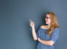 Smiling woman pointing finger Royalty Free Stock Photo