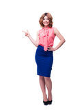 Smiling woman pointing finger away Royalty Free Stock Photo