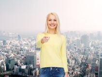 Smiling woman pointing finger at you Royalty Free Stock Photography