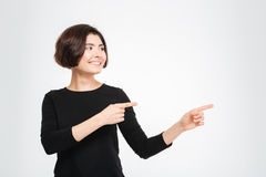Smiling woman pointing fingers away Royalty Free Stock Photos