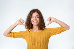 Smiling woman pointing fingers on herself Stock Images