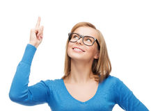 Smiling woman pointing her finger up Stock Image