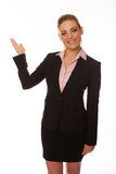Smiling woman pointing with her hand Royalty Free Stock Photos